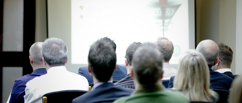 Delegates at a conference at Stirk House.